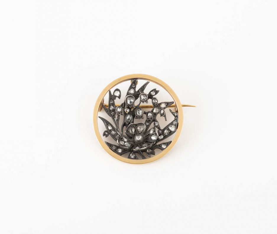 Broche ronde florale avec diamants