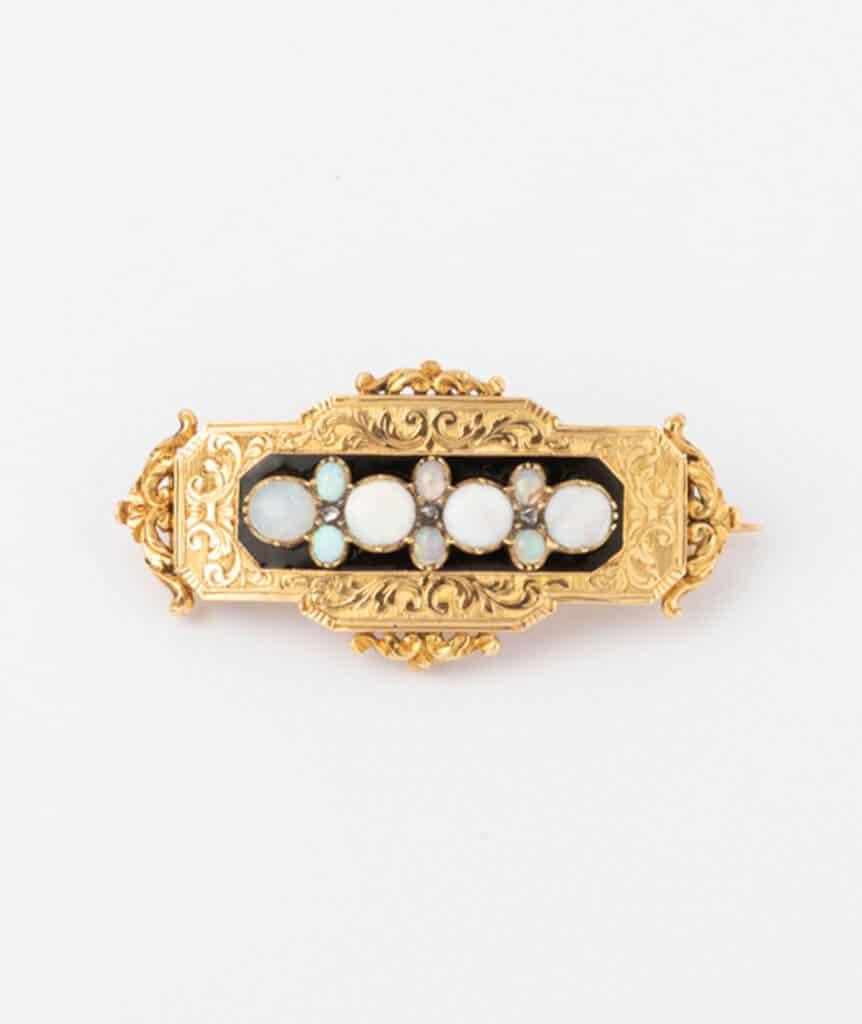 Broche porte-montre avec opales