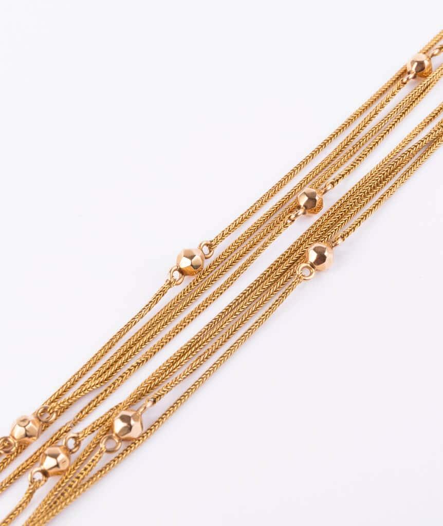 Sautoir perles d'or détail 1