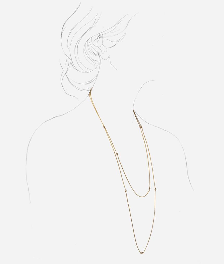 Sautoir perles d'or
